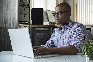 black man at computer_300